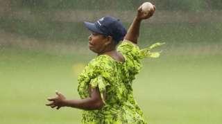 A Ni-Vanuatu woman playing island cricket