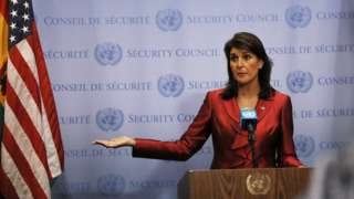 file image of Nikki Haley giving a speech, next to an American flag