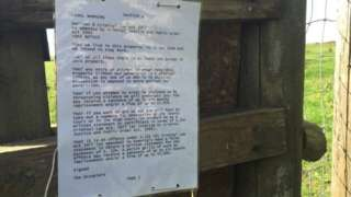 Warning notice at the camp in Swanage