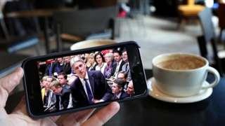 Man watching Budget on smartphone