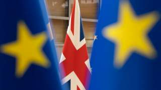 File photo of Union Jack and EU flags in Brussels