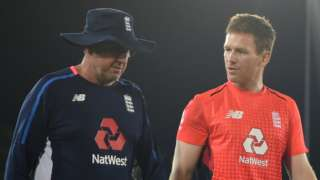 England coach Trevor Bayliss and captain Eoin Morgan talk as they cross the outfield in Dambulla after the first ODI against Sri Lanka was abandoned