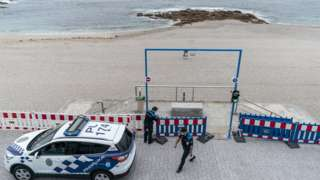 The local police cordon off access to Riazor beach on June 23, 2020 in A Coruna, Spain.