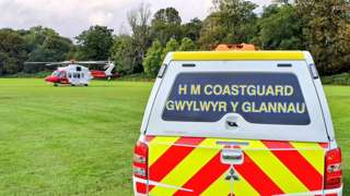 HM Coastguard helicopter and 4x4 vehicle