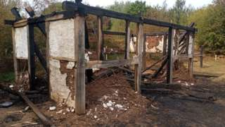 Fire damaged reconstruction of Anglo-Saxon building