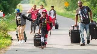 Refugees cross at Roxham Road in Quebec