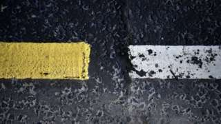 A change in road markings and tarmac designates the border between the Republic of Ireland (L) and Northern Ireland (R) on the A13 Road near Londonderry in Britain 01 March 2019 (reissued 15 March 2021).