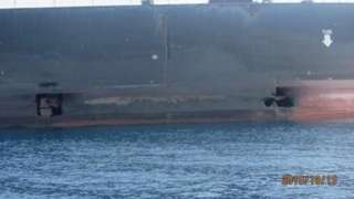 Photo of two holes in an Iranian tanker