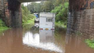 Cars and campervans flooded in tunnel