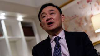 Deposed former Thai premier Thaksin Shinawatra speaks during an interview in New York, on March 9, 2016