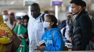 One passenger wear a mask as she dey wait for Bole International Airport for Addis Ababa
