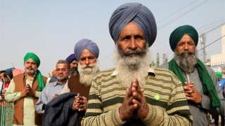 An elderly Sikh protester stands for Ardas (Sikhism worship) at Singhu border during the demonstration.Thousands of farmers from Punjab, Haryana and other states gathered for the 28th day protesting against the Government's new agricultural law, demanding to rollback these new bills.