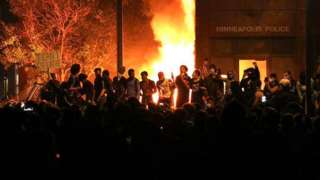 Protesters set fireworks after overrunning the Third Precinct police station and setting it ablaze.