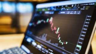 Stock market data on laptop