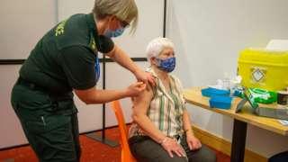 Elderly woman receives Covid vaccine
