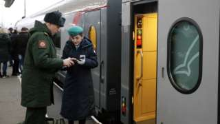 Passengers board the Tavria train to Sevastopol from the Moscow railway station in St. Petersburg, Russia, 23 December 2019