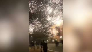 Firework exploding close to people