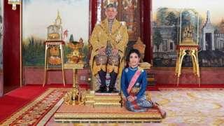 "Thailand""s King Maha Vajiralongkorn and General Sineenat Wongvajirapakdi, the royal noble consort pose at the Grand Palace in Bangkok, Thailand, in this undated handout photo obtained by Reuters August 27, 2019."