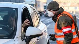 A driver is checked on February 12, 2021 at the Austrian-German border in Kufstein in Austria's Tyrol