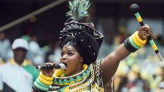 A praise singer takes to the stage to traditionally welcome African National Congress