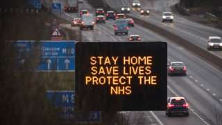 Stay home sign on motorway
