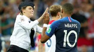 Intruder high-fiving with Mbappé