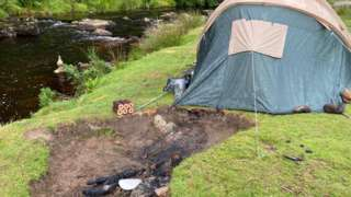 Tent with abandoned fire pit
