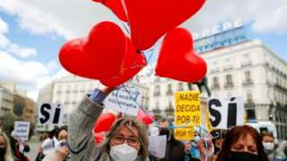Supporters of a law to legalise euthanasia gather as the Spanish Parliament votes to approve it, in Madrid, Spain