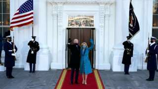President Joe Biden and First Lady Dr Jill Biden wave on the steps of The White House