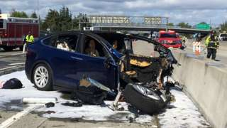 Rescue workers attend the scene where a Tesla electric SUV crashed into a barrier on U.S. Highway 101 in Mountain View, California, 25 March.