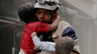White Helmet volunteer rescues two children in Aleppo (file photo)