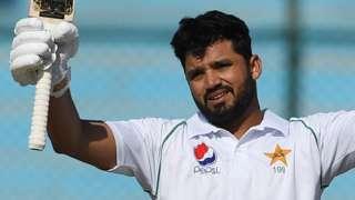 Pakistan batsman Babar Azam raises his bat in celebration after reaching his ton in the second Test against Sri Lanka