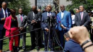Al Sharpton and members of Floyd family