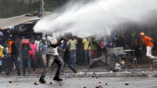 A supporter of Kenyan opposition leader Raila Odinga is sprayed with water by police in Nairobi, Kenya on 17 November 2017