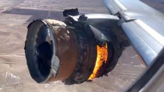The plane's engine in flames filmed from the passenger window