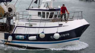 File picture of a French fisherman returning after protests in Jersey's waters