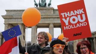 Demonstrators in Germany welcome the result of the Dutch election, 16 March 2017