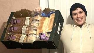 Adam Ellison holding baskets of food