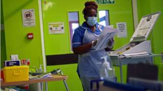 A nurse wears a face mask in Blackburn in May