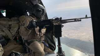 Coalition forces in a helicopter