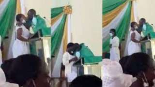 Anglican priest kiss students