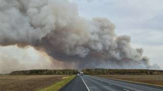 Smoke rises from the site of a fire at an ammunition depot in the Ryazan region of Russia, 7 October 2020