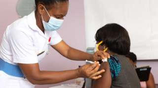Woman in Accra, Ghana being vaccinated