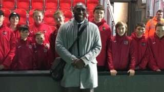 Sol Campbell poses for a photo