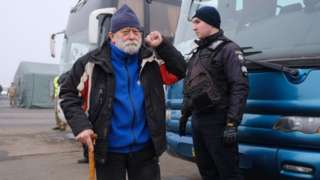 Pro-Russian rebels - who were made prisoners - are seen before a prisoner exchange between Ukraine and pro-Russian rebels near the Mayorsk checkpoint on December 29, 2019.