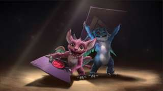 Two little monsters hold playing cards in this promotion image