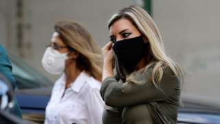 Women wearing face masks walk along a street in Beirut, Lebanon (2 November 2020)