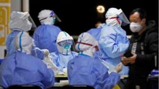 Medical staff in Hazmat suits