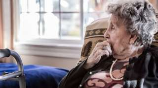 Woman sitting in a care home