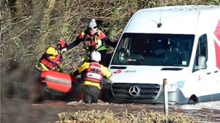 Emergency services rescue a DPD delivery van driver stranded in flood water in Newbridge on Usk